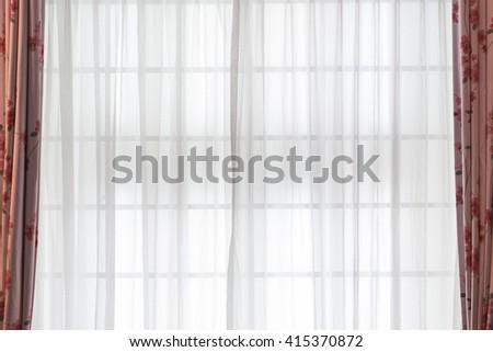 Transparent curtain on window. Curtain background - stock photo