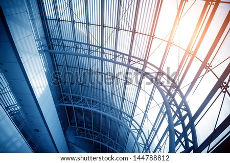 Transparent glass ceiling, modern architectural interior.