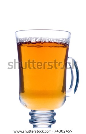 Transparent glass of tea isolated on white