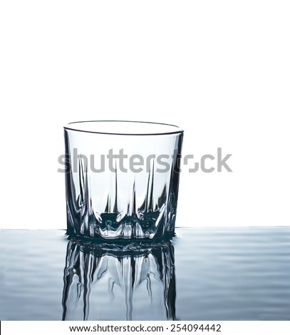 transparent glass reflected in water - stock photo
