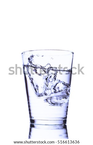 Transparent Glass With Fresh Wavy Water On Pure White Background.