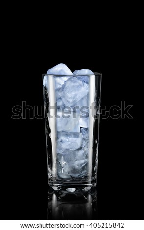 Transparent glass with ice on a black background.