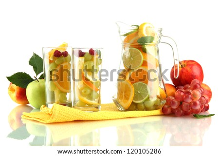 transparent jar and glasses with citrus fruits, isolated on white - stock photo