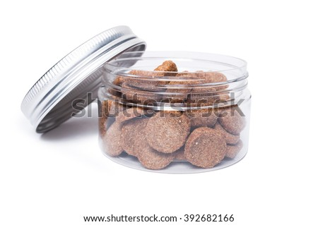 Transparent jar of cat or dog food isolated on white background - stock photo