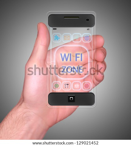 Transparent Mobile Smart Phone in man's Hand showing WI-FI Zone on screen new Digital Technology - stock photo