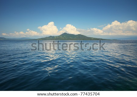 Transparent sea and white clouds. Bunaken island. indonesia - stock photo