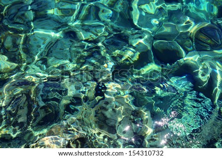 Transparent sea water and pebbles - stock photo