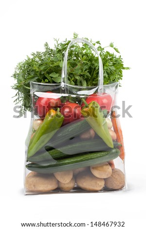 Transparent shopping bag with different fresh vegetables.  - stock photo