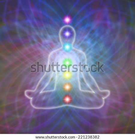 Transparent silhouette of a man sitting in lotus position meditating in a complex energy matrix with the seven chakras positioned centrally in the mid line of the body - stock photo