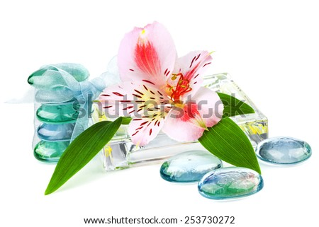 Transparent spa concept with flower and green leaves isolated on white background - stock photo