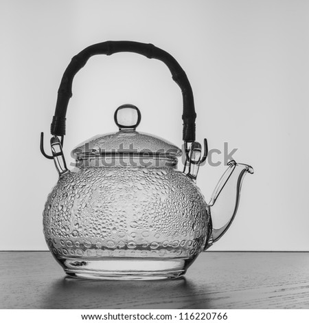 Transparent teapot black and white silhouette - stock photo