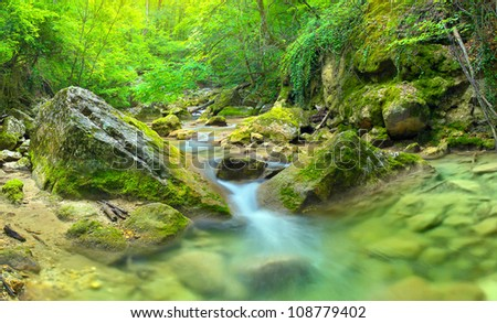 Transparent water in bright canyon. Natural composition - stock photo