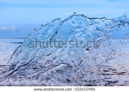 Transparent water splash on sea background - stock photo