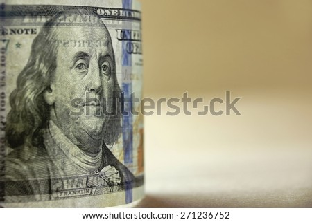 Transparently New USA One Hundred Dollar Bill In Back Light Close-up With Watermarks Detail On Beige Background - stock photo
