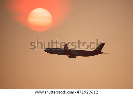 Transport aircraft in the sky at sunset