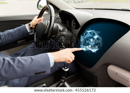 transport, business, modern technology and people concept - close up of man driving car and pointing finger to low poly shape on board computer screen