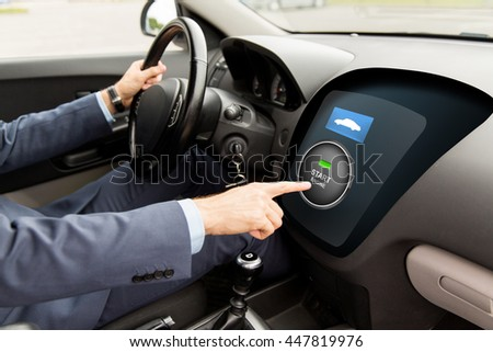 transport, business trip, technology and people concept - close up of man driving car and pushing start engine button on board computer - stock photo