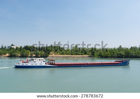 Transport by industrial boat on the river - stock photo