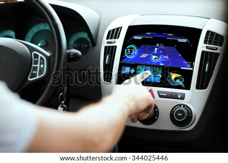 transport, destination, modern technology and people concept - male hand searching for route using navigation system on car dashboard screen - stock photo