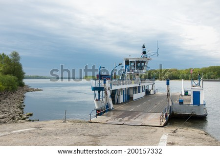 transport ferry docking on the banks of the danube river, Vac, Hungary - stock photo
