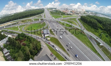 Transport traffic on Novorizhskaja flyover and Moscow ring road at summer day. Aerial view. Photo with noise from action camera. - stock photo