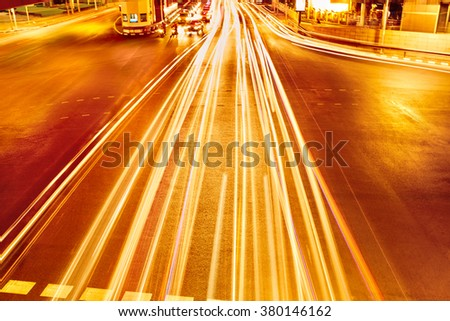 Transportation. Abstract Urban Background. Speed Traffic On Motorway ( Highway ) At Night, Light Trails On The Street In Bangkok, Thailand. Moving Car With Blur Lights On The Road Through Modern City. - stock photo