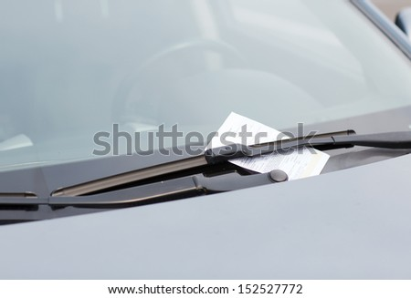 transportation and vehicle concept - parking ticket on car windscreen - stock photo