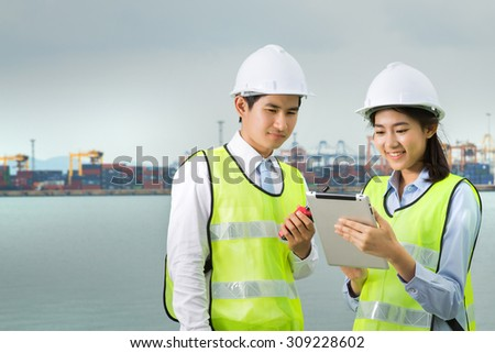 Transportation engineers were checking the goods via tablet. The shipping dock - stock photo