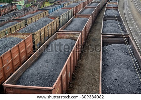 Transportation of coal in commodity cars - stock photo