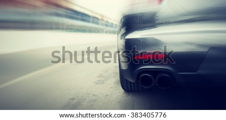 transportation, speed, racing and road concept - close up of car riding on highway from back - stock photo