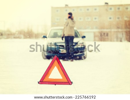 transportation, winter and vehicle concept - closeup of man with broken car, warning triangle and smartphone - stock photo