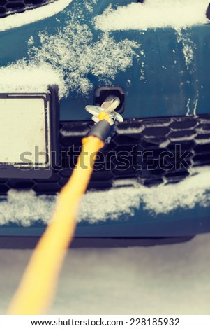 transportation, winter and vehicle concept - closeup of towed car with towing rope - stock photo
