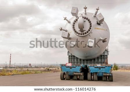 Transporting mega installation to refinery - stock photo