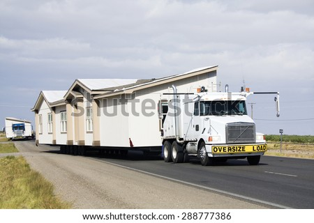 Transporting portable homes - New Mexico. - stock photo