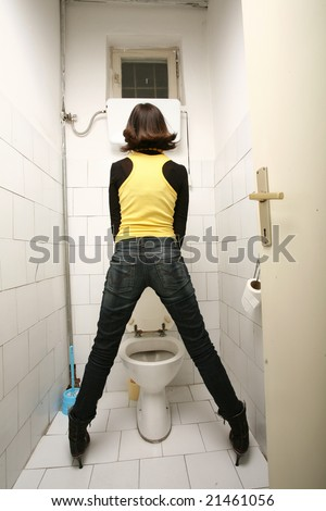 Transvestite standing in Toilet and pee. Person in woman clothes in man WC