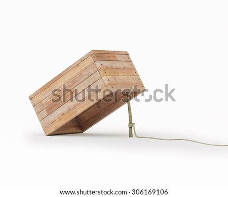 Trap made out of a box and a rope tide to a stick - stock photo