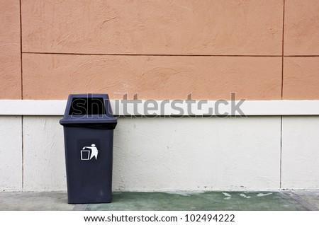 trash and wall. - stock photo