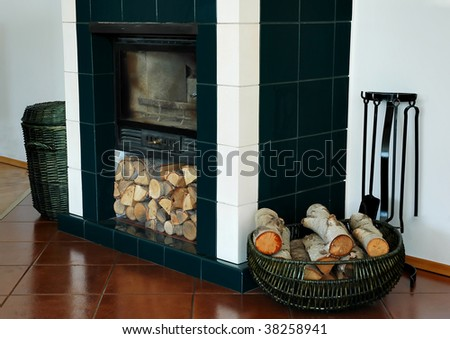 Trash and wood standing at the fireplace - stock photo