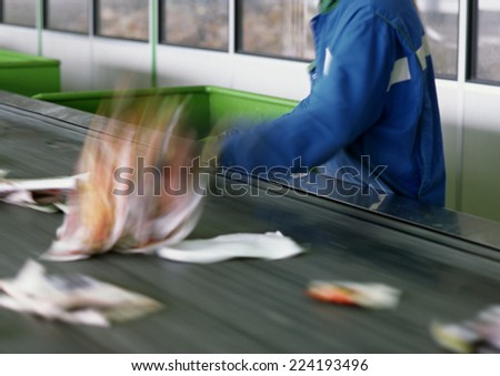 Trash being sorted on conveyor belt, cropped - stock photo