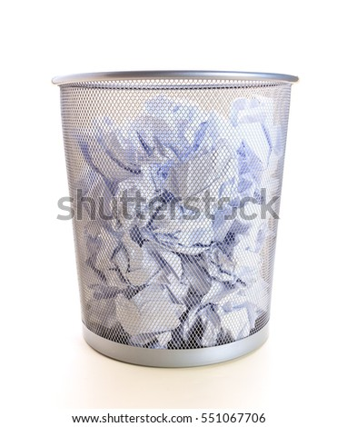 Trash can filled with almost crumbled paper isolated on white background