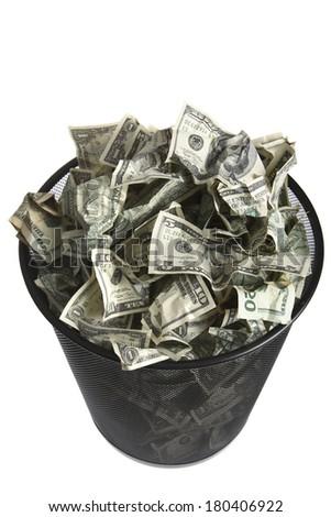 Trash can full of dollar bills - stock photo