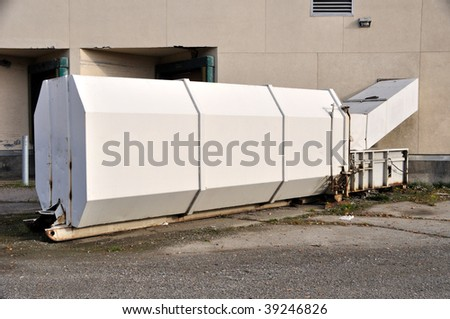 Trash compactor at Department Store - stock photo