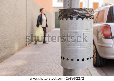 Trash metal gray for the collection of waste of the road - stock photo
