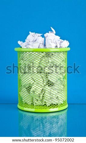 trash on a blue background - stock photo