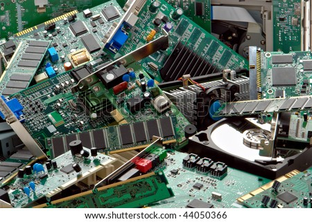 Trash pile of discarded computer parts with circuit boards and memory modules ready for dismantlement and electronics components recycling (all logos and trademark markings have been removed) - stock photo