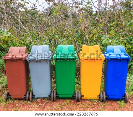 Trash recycling container ecology concept, with landscape background - stock photo