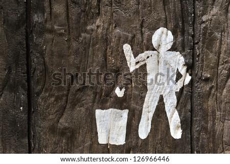 Trash symbol on wood - stock photo