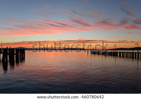 Trasimeno lake from the waterfront of the Passignano sul Trasimeno town - Sunset
