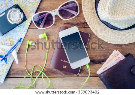 Travel accessories costumes. Passports, luggage, eyewear The cost of travel maps prepared for the trip - stock photo