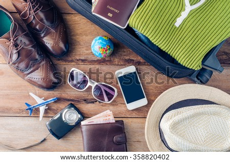 Travel accessories costumes. Passports, luggage, sunglasses The cost of travel maps prepared for the trip - stock photo